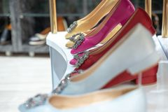 Woman shoe on the shelf for sales in the fashion store royalty free stock image