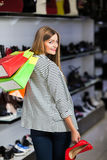 Woman in shoe store Stock Photo