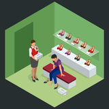 Woman at shoe store. Young woman choosing shoes in a shoe store. Shoes stand high heels. Isometric vector illustration. For infographics Stock Photos