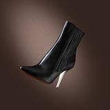 Woman shoes. On the dark background stock images