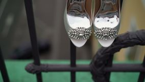Woman shoes on balcony stock footage