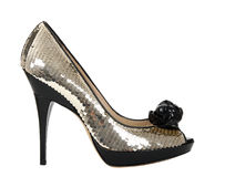 Woman shoes with golden sequin Royalty Free Stock Images