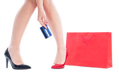 Woman shoes and legs, shopping bag and card Stock Images