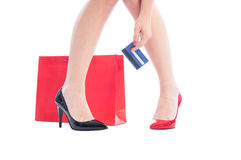 Woman shoes and legs, shopping bag and credit card Royalty Free Stock Photos