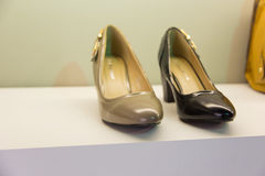 Woman shoes. Luxury and fashionable brand new interior of woman shoes store Royalty Free Stock Images