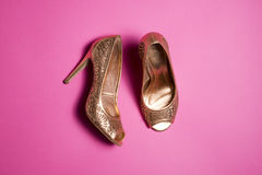 Woman shoes on pink background. Leather woman shoes isolated on pink background Stock Photo