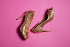 Woman shoes on pink background. Leather woman shoes isolated on pink background Royalty Free Stock Images