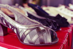 Woman shoes on sale in a street market, filtered Royalty Free Stock Images