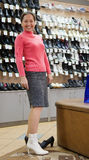 Woman   at shoes shop Stock Image