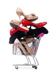 Woman shoes in shopping cart on the white Royalty Free Stock Images