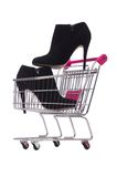 Woman shoes in shopping cart on the white Stock Image