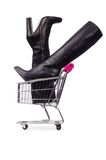 Woman shoes in shopping cart on the white Royalty Free Stock Photos