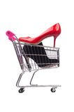 Woman shoes in shopping cart on white Stock Photo