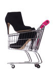 Woman shoes in shopping cart on white Royalty Free Stock Image