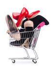 Woman shoes in shopping cart on white Stock Images