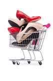 Woman shoes in shopping cart on white Royalty Free Stock Photos