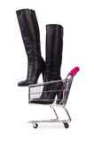 Woman shoes in shopping cart on white Stock Photography