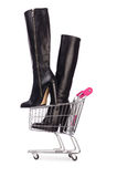 Woman shoes in shopping cart on white Stock Photos