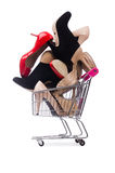 Woman shoes in shopping cart on white Royalty Free Stock Photo
