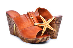 Woman shoes with starfish isolated on white Royalty Free Stock Image