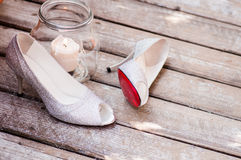 Woman shoes on wood texture. Woman glamour shoes isolated on wood texture Stock Images