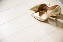 Woman shoes on wood texture. Woman glamour shoes isolated on wood texture Royalty Free Stock Photos