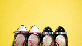 Woman shoes on yellow background. Leather woman shoes isolated on yellow background Royalty Free Stock Photo