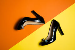 Woman shoes on yellow background. Leather woman shoes isolated on yellow background Royalty Free Stock Images