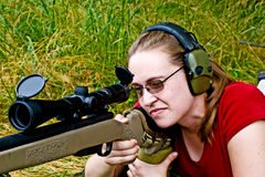 Woman Shooting. Woman behind a .223 caliber rifle, shooting targets in a field Stock Images