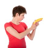 Woman shooting with a banana Royalty Free Stock Photography