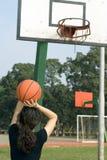 Woman Shooting Basketball At The Ho Stock Photos