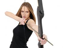Woman shooting with bow and arrow. Beautiful woman aiming and shooting with bow and arrow Royalty Free Stock Image