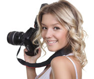 Woman shooting with a camera Stock Images