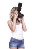 Woman shooting with a camera Stock Photos