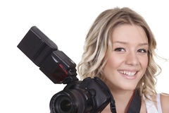 Woman shooting with a camera Stock Image