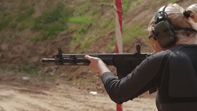 HD Footage. Woman shooting a carbine stock footage