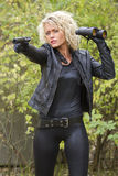 Woman Shooting From Silencer Handgun Royalty Free Stock Photos