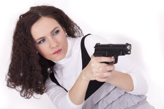 Woman shooting from gun Royalty Free Stock Photography