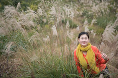 Woman Shooting in Miscanthus Background Royalty Free Stock Image