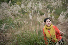 Woman Shooting in Miscanthus Background Stock Image