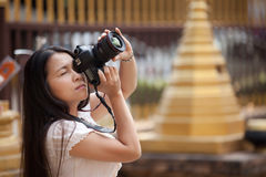Woman shooting photo Stock Photo