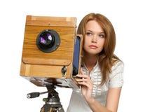 Woman shooting photos with vintage camera stock photos