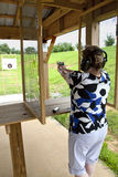 Woman at shooting range Stock Photo