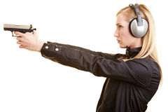 Woman on a shooting range Royalty Free Stock Images