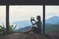 Woman is shooting video of wonderful view of subtropical forest  during her travel in Thailand Royalty Free Stock Image
