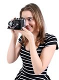 Woman shooting a vintage camera Royalty Free Stock Image