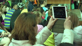 Woman shoots iPad children`s holiday. 4K. Woman shoots iPad children`s holiday. Shot in 4K ultra-high definition UHD, so you can easily crop, rotate and zoom stock footage