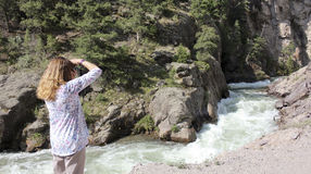 A Woman Shoots Photos on the Alpine Loop Backcountry Byway Royalty Free Stock Photos