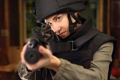 Woman shoots a rifle at the shooting range Stock Photos
