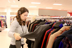 Woman in shop. Woman shopping in clothes shop Stock Images